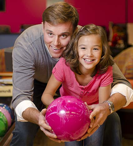 Father & Daughter Set To Bowl